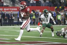 Rhamondre Stevenson of the Oklahoma Sooners, scores the winning touchdown against the Baylor Bears in the Big 12 Championship on Dec. 7, 2019. | Ron Jenkins/Getty Images
