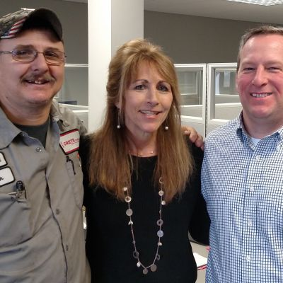 Jeanne Burkart with her rescuers Wade Petray and Colin Lee