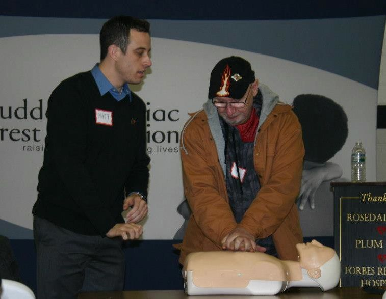 Matt Strauss, left, teaching CPR-AED class